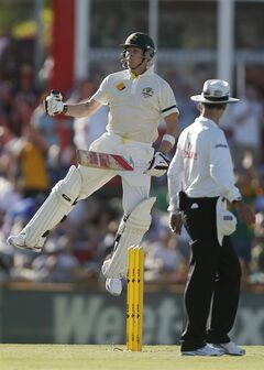 Australia's Steve Smith jumps in the air to celebrate scoring 100 runs against England on the first day of their Ashes cricket test match in Perth, Australia, Friday Dec. 13, 2013. (AP Photo/Theron Kirkman)