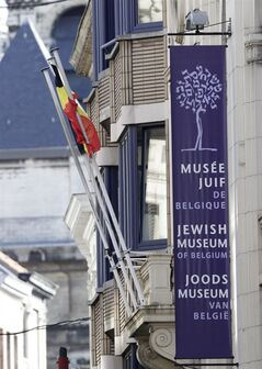 A banner shows the facade of the Jewish museum, the site of a shooting in Brussels, Saturday, May 24, 2014. Belgian officials say that at least three people have been killed in gunfire at the Jewish Museum in Brussels. Belgian Foreign Minister Didier Reynders, in a post on Twitter, said he was