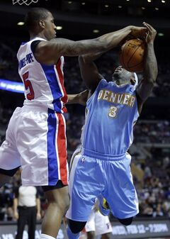 Detroit Pistons guard Kentavious Caldwell-Pope (5) blocks a shot by Denver Nuggets guard Ty Lawson (3) during the first half of an NBA basketball game on Saturday, Feb. 8, 2014, in Auburn Hills, Mich. (AP Photo/Duane Burleson)