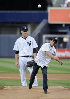 New York Yankees pitcher David Phelps, left, watches California Chrome jockey Victor Espinoza throw out the first ceremonial pitch before the baseball game between the Yankees and the Seattle Mariners at Yankee Stadium on Monday, June 2, 2014, in New York. (AP Photo/Kathy Kmonicek)