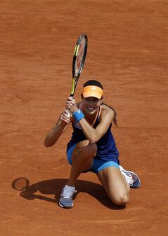 Serbia's Ana Ivanovic kneels after returning the ball to Lucie Safarova of the Czech Republic during their third round match of the French Open tennis tournament at the Roland Garros stadium, in Paris, France, Saturday, May 31, 2014. (AP Photo/David Vincent)