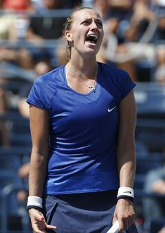 Petra Kvitova, of the Czech Republic, reacts after a point to Aleksandra Krunic, of Serbia, during the third round of the 2014 U.S. Open tennis tournament, Saturday, Aug. 30, 2014, in New York. (AP Photo/Kathy Willens)
