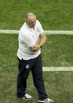 Brazil's coach Luiz Felipe Scolari stands during the World Cup third-place soccer match between Brazil and the Netherlands at the Estadio Nacional in Brasilia, Brazil, Saturday, July 12, 2014. (AP Photo/Themba Hadebe)