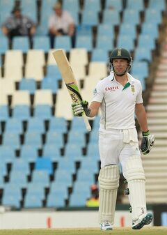 South Africa's batsman AB de Villiers, raises his bat after reaching a half century on the second day of their their cricket test match against Australia at Centurion Park in Pretoria, South Africa, Thursday, Feb. 13, 2014. (AP Photo/Themba Hadebe)