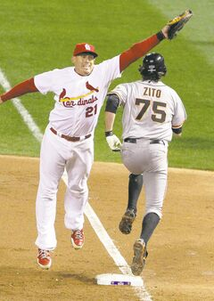 St. Louis Cardinals first baseman Allen Craig is pulled off the bag on a throw from third baseman David Freese as Barry Zito of the San Francisco Giants reaches safely on a bunt in the fourth inning in Game 5 Friday. The never-say-die Giants are hoping to pull off some playoff magic one more time.