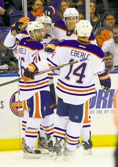 Oilers' Taylor Hall (4), Mark Arcobello (26), Jeff Petry (2) and Jordan Eberle (14) celebrate Hall's second goal Thursday.
