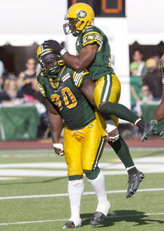 Celebration was largely an Eskimosonly affair Saturday: Almondo Sewell (90) and T.J. Hill celebrate a sack on Justin Goltz in the first half.