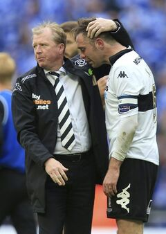 Derby County manager Steve McClaren, left, consoles his palayer Richard Keogh after the English Championship Play Off Final against Queens Park Rangers at Wembley Stadium, London Saturday May 24, 2014. QPR won the match and gained promotion to the English Premier League next season. (AP Photo/Mike Egerton/PA) UNITED KINGDOM OUT NO SALES NO ARCHIVE