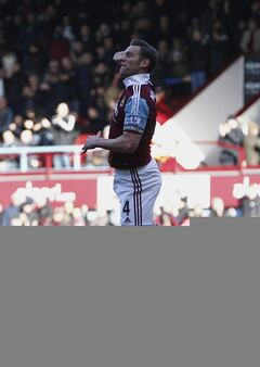 West Ham United's Kevin Nolan celebrates his goal against Swansea City during their English Premier League soccer match at Upton Park, London, Saturday, Feb. 1, 2014. (AP Photo/Sang Tan)