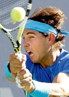 Rafael Nadal blisters a return at Andy Roddick on Friday.