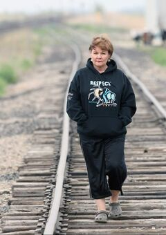 Carol de Delly walks along the railway tracks near her home in Elie, Manitoba.