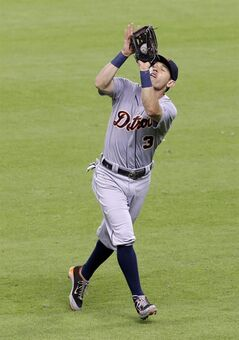 Detroit Tigers second baseman Ian Kinsler makes the catch and the out on Houston Astros' Matt Dominguez in the fourth inning of a baseball game Saturday, June 28, 2014, in Houston. (AP Photo/Pat Sullivan)