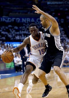 Oklahoma City Thunder guard Reggie Jackson (15) drives against San Antonio Spurs guard Tony Parker (9) during the first half of Game 6 of the Western Conference finals NBA basketball playoff series in Oklahoma City, Saturday, May 31, 2014. (AP Photo/Sue Ogrocki)