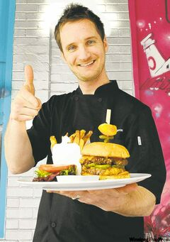 Chef Brandon Thordarson with the Sedin Twin Burger, in honour of Vancouver Canucks Henrik and Daniel Sedin.