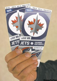 Hand holding a pair of Winnipeg Jets tickets. 110916 - Friday, Sept. 16, 2011 (Mike Aporius / Winnipeg Free Press)