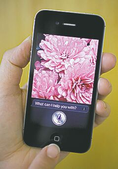 Siri, the virtual assistant, is displayed on the  Apple iPhone 4S.