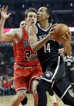 Brooklyn Nets guard Shaun Livingston (14) drives to the basket against Chicago Bulls guard Mike Dunleavy during the first half of an NBA basketball game in Chicago on Thursday, Feb. 13, 2014. (AP Photo/Nam Y. Huh)