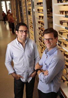 Neil Blumenthal, left, and Dave Gilboa, pictured July 23, 2013, are behind Warby Parker, an online eye-wear company. They're undercutting an industry giant, Luxottica.