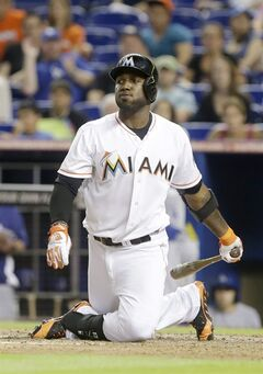 Miami Marlins' Marcell Ozuna strikes out to end the 10th inning of a baseball game against the Los Angeles Dodgers, Saturday, May 3, 2014 in Miami. The Dodgers defeated the Marlins 9-7 in 11 innings. (AP Photo/Wilfredo Lee)