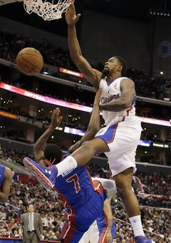 Los Angeles Clippers center DeAndre Jordan (6) dunks the basket and falls on Detroit Pistons guard Brandon Knight (7), who gets a foul, in the first half of an NBA basketball game in Los Angeles Sunday, March 10, 2013. (AP Photo/Reed Saxon)