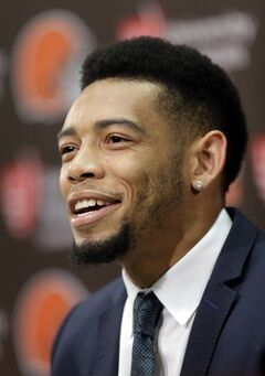 Cleveland Browns cornerback Joe Haden answers questions during his news conference in Berea, Ohio Wednesday, May 14, 2014. Haden signed a five-year contract extension with the NFL football team Tuesday. (AP Photo)