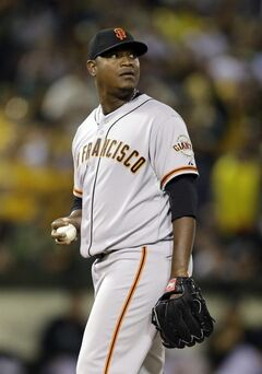San Francisco Giants' Juan Gutierrez waits to pitch against the Oakland Athletics in the seventh inning of a baseball game Monday, July 7, 2014, in Oakland, Calif. (AP Photo/Ben Margot)