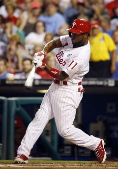 Philadelphia Phillies' Jimmy Rollins hits a home run off Washington Nationals starting pitcher Doug Fister during the first inning of a baseball game, Wednesday, Aug. 27, 2014, in Philadelphia. (AP Photo/Matt Slocum)