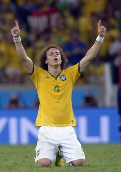 Brazil's David Luiz celebrates at the end of the World Cup quarterfinal soccer match between Brazil and Colombia at the Arena Castelao in Fortaleza, Brazil, Friday, July 4, 2014. Brazil won the match 2-1. (AP Photo/Manu Fernandez)