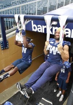 After the team's walk-through at Investors Group Field Thursday, Winnipeg Blue Bomber linebackers Rene Stephan, right, and Abraham Kromah do some exercising before hitting the dressing room.