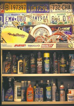Popular brand names such as Meguiars, Mothers and Eagle One fill the shelves of a cabinet in Willy's Garage. You can purchase auto-detailing supplies at your favourite automotive parts store.