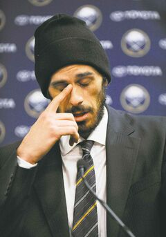 Former Buffalo Sabres goaltender Ryan Miller collects his thoughts during Friday's news conference.