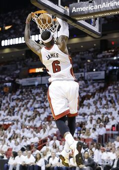 Miami Heat forward LeBron James dunks the ball during the first half of Game 2 of an Eastern Conference semifinal basketball game against the Brooklyn Nets, Thursday, May 8, 2014 in Miami. (AP Photo/Wilfredo Lee)