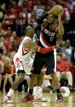 Portland Trail Blazers' LaMarcus Aldridge (12) keeps the ball from Houston Rockets' Dwight Howard, left, during the third quarter in Game 2 of an opening-round NBA basketball playoff series Wednesday, April 23, 2014, in Houston. Portland won 112-105. (AP Photo/David J. Phillip)