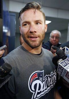 New England Patriots wide receiver Julian Edelman talks with reporters following an NFL football organized team activity in Foxborough, Mass., Thursday, June 5, 2014. (AP Photo/Michael Dwyer)
