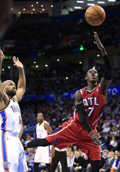 Atlanta Hawks guard Dennis Schroder, right, goes to the basket in front of Oklahoma City Thunder guard Derek Fisher, left, during the second quarter of an NBA basketball game Monday, Jan. 27, 2014, in Oklahoma City. (AP Photo/Alonzo Adams)
