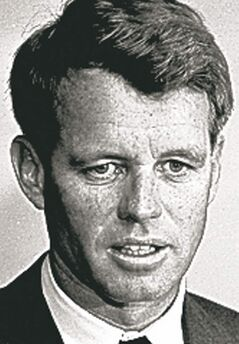 File -- A 1964 file photo shows then U.S. Attorney Gen. Robert F. Kennedy in his office in Washington, D.C. Kennedy owned one of 48 printed copies of the Emancipation Proclamation that were signed by Lincoln, and now the copy Kennedy purchased in 1964 is being sold by his widow, Ethel, in a Dec. 10 sale at Sotheby's. (AP Photo)