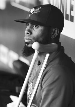 Jose Reyes watches the Royals game from Jays' dugout.