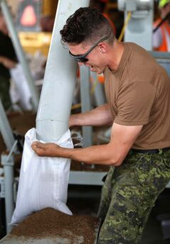 Soldiers from CFB Shilo, who along with members of the Portage la Prairie Municipality, were filling sandbags at the Portage Yard, Saturday, July 5.