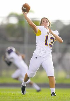South Plantation High School quarterback Erin Dimeglio warms up.