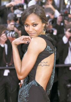 Actress Zoe Saldana poses for photographers on the red carpet for the screening of Mr. Turner at the 67th international film festival, Cannes, southern France, Thursday, May 15, 2014. (Photo by Joel Ryan/Invision/AP)