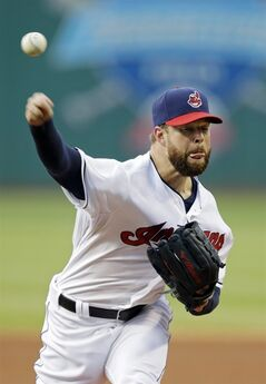Cleveland Indians starting pitcher Corey Kluber delivers against the Cincinnati Reds in the first inning of a baseball game Monday, Aug. 4, 2014, in Cleveland. (AP Photo/Mark Duncan)
