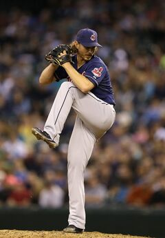Cleveland Indians starting pitcher Josh Tomlin begins his windup in the eighth inning of a baseball game against the Seattle Mariners, Saturday, June 28, 2014, in Seattle. (AP Photo/Ted S. Warren)