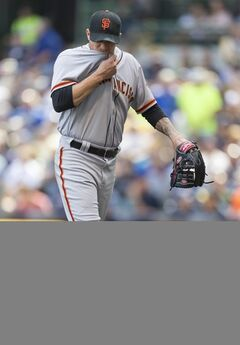 San Francisco Giants' Jake Peavy is taken out of the game against the Milwaukee Brewers' during the sixth inning of a baseball game Thursday, Aug. 7, 2014, in Milwaukee. (AP Photo/Tom Lynn)