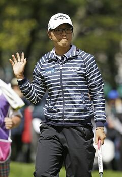 Lydia Ko of New Zealand, waves after making a birdie putt on the sixth green of the Lake Merced Golf Club during the third round of the Swinging Skirts LPGA Classic golf tournament on Saturday, April 26, 2014, in Daly City, Calif. (AP Photo/Eric Risberg)