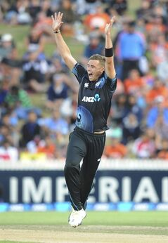 New Zealand's Tim Southee celebrates the dismissal of India's Rohit Sharma for 20 in the second one day International cricket match at Seddon Park in Hamilton, New Zealand, Wednesday, Jan. 22, 2014. (AP Photo/SNPA, Ross Setford) NEW ZEALAND OUT