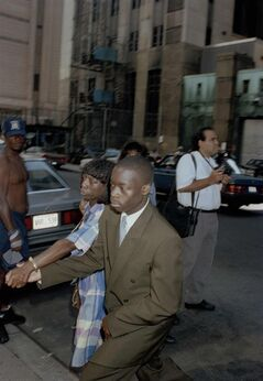 FILE - In this Aug. 14, 1990 file photo, Antron McCray arrives with his mother Linda for court in connection with the Central Park jogger trial in New York. On Friday, June 20, 2014, the city has agreed to a $40 million settlement in a civil rights lawsuit filed against police and prosecutors by Antron McCray and four co-defendants exonerated in the notorious case, a city official said. (AP Photo/Malcolm Clarke, File)