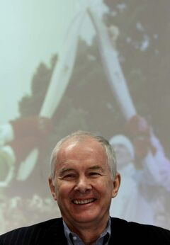 Vancouver Olympics Organizing Committee CEO John Furlong smiles as he announces the 2010 Games broke even.