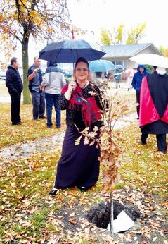 Cuthbert Grant descendant Sandra Horyski stands next to a tree planted as part of the memorial service for Grant held at St. Francois Xavier Roman Catholic Parish on Sept. 28, 2013.