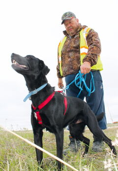 Rene Belliveau and his dog Shadow are at the ready to track lost pets.