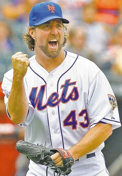 FULL CLOSE CUT CLOSECUT -  This Aug. 25, 2012 file photo shows New York Mets pitcher R.A. Dickey reacting to a big double play to end the 5th inning of a baseball game against the Houston Astros at Citi Field in New York. Dickey is a favorite to take home the AL Cy Young Award, Wednesday, Nov. 14, 2012. (AP Photo/Paul J. Bereswill, File)